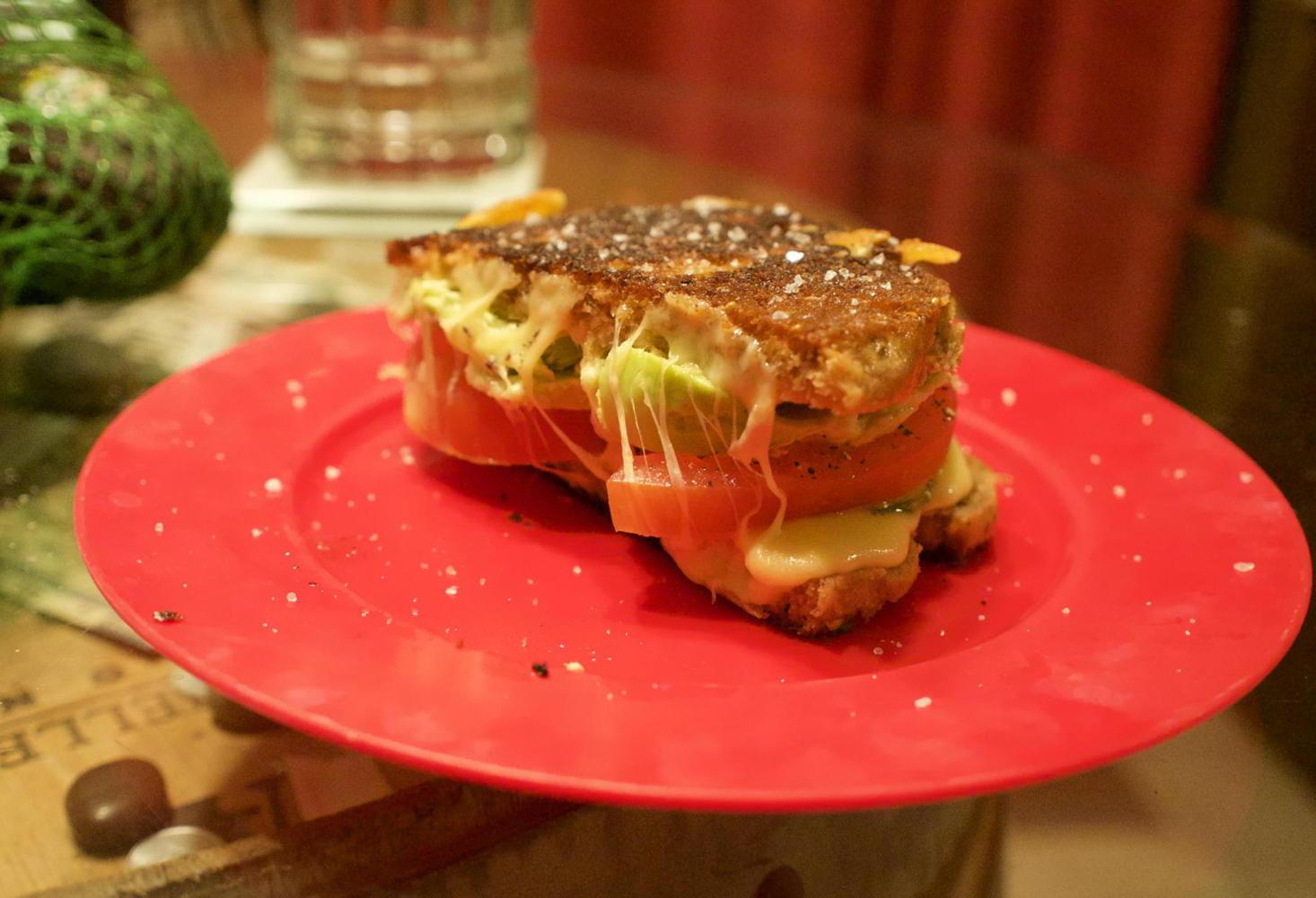 Avocado tomato gouda sandwich
