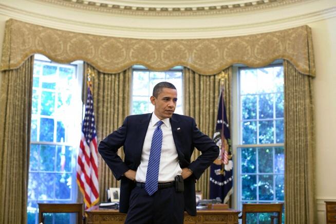 Barack Obama listens to a point