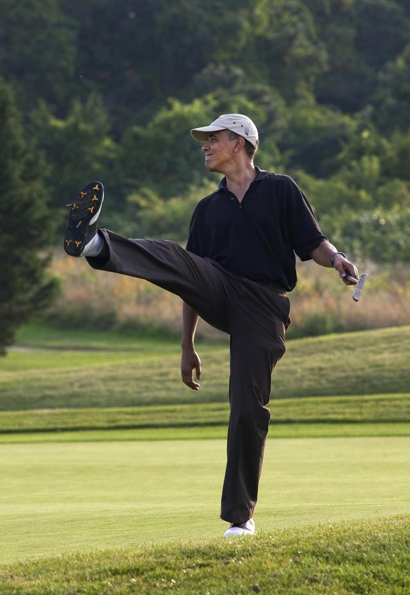 President Obama golfs