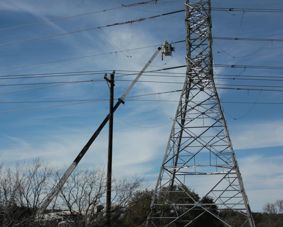 Electricity transmission tower erection on the U.S. Route 90 in Texas